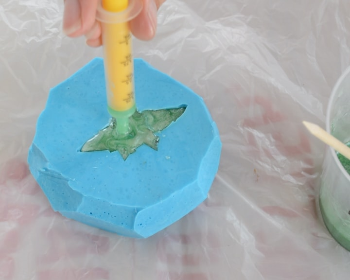 squirting resin into a silicone mold