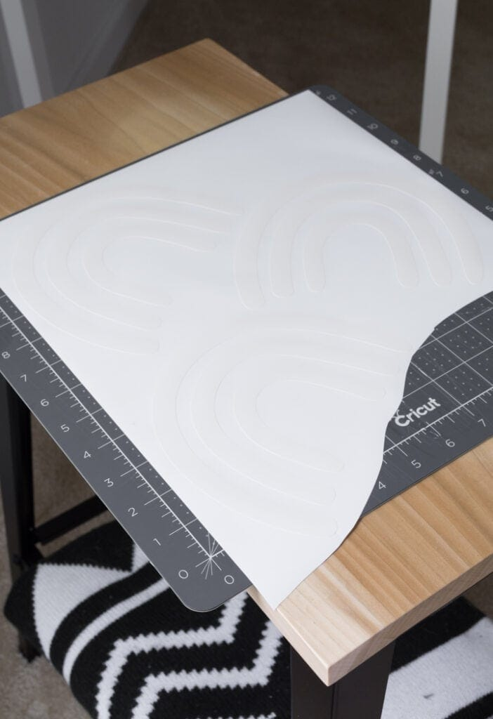 removing negative space after cutting vinyl on a Cricut machine to make DIY wall decals