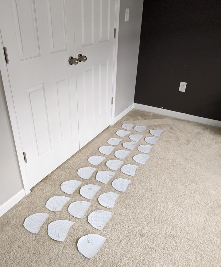 decals lined up on the floor ready to adhere
