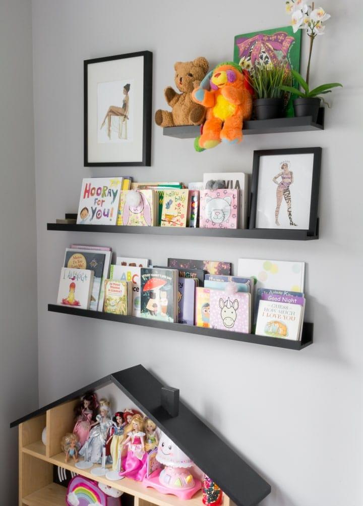 books on book shelf ledges in a kids room