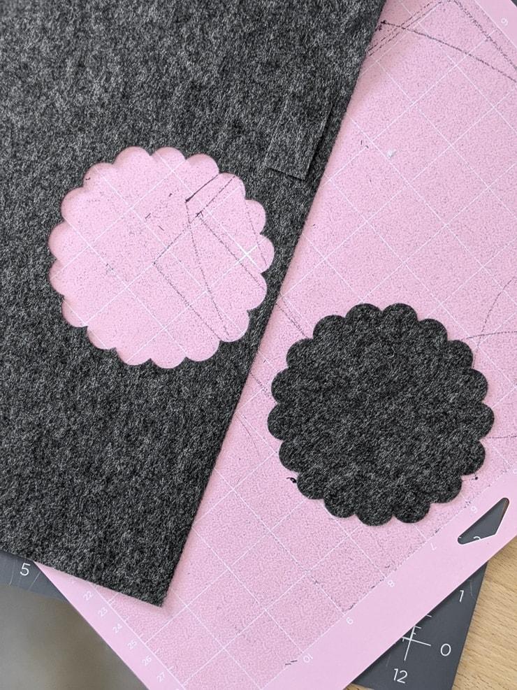 Cutting a shape out of felt to make a dollhouse rug
