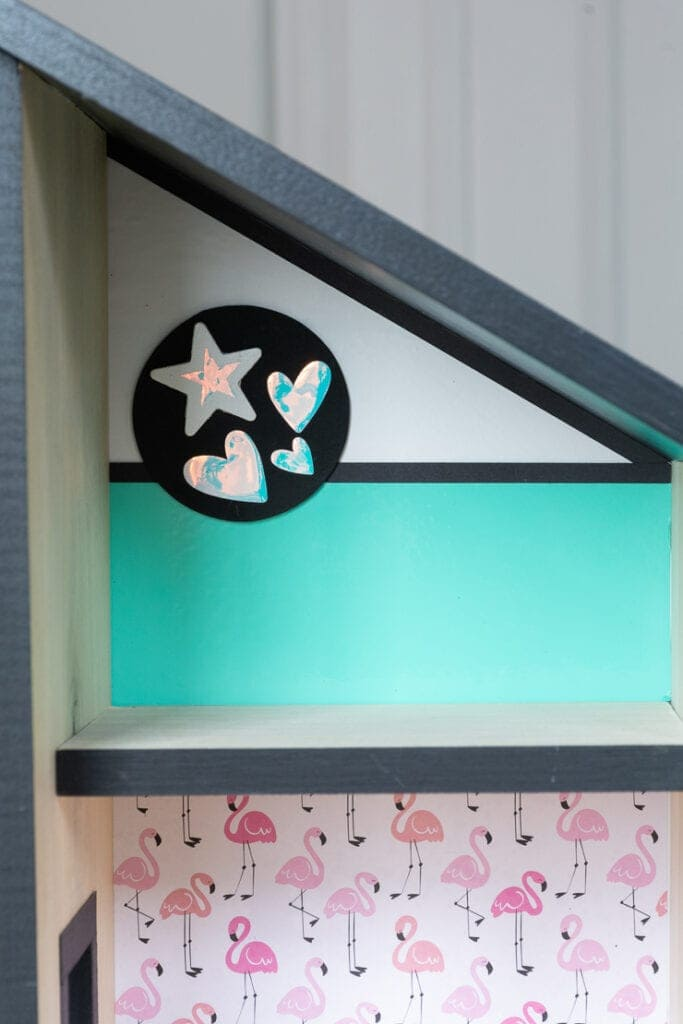 creating dollhouse wall art using a painted wooden circle with adhesive vinyl