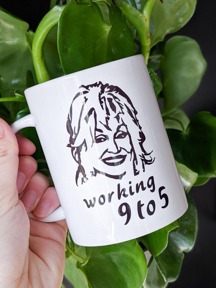 Cricut mug blank customized with a Dolly Parton svg file and a Cricut Mug Press