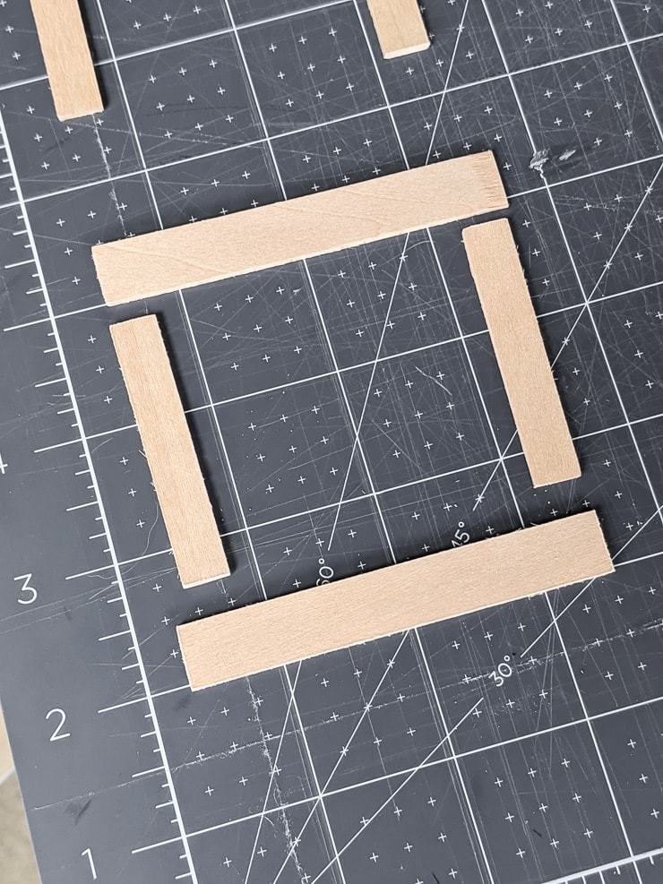 Pieces of cut basswood for the dollhouse trim