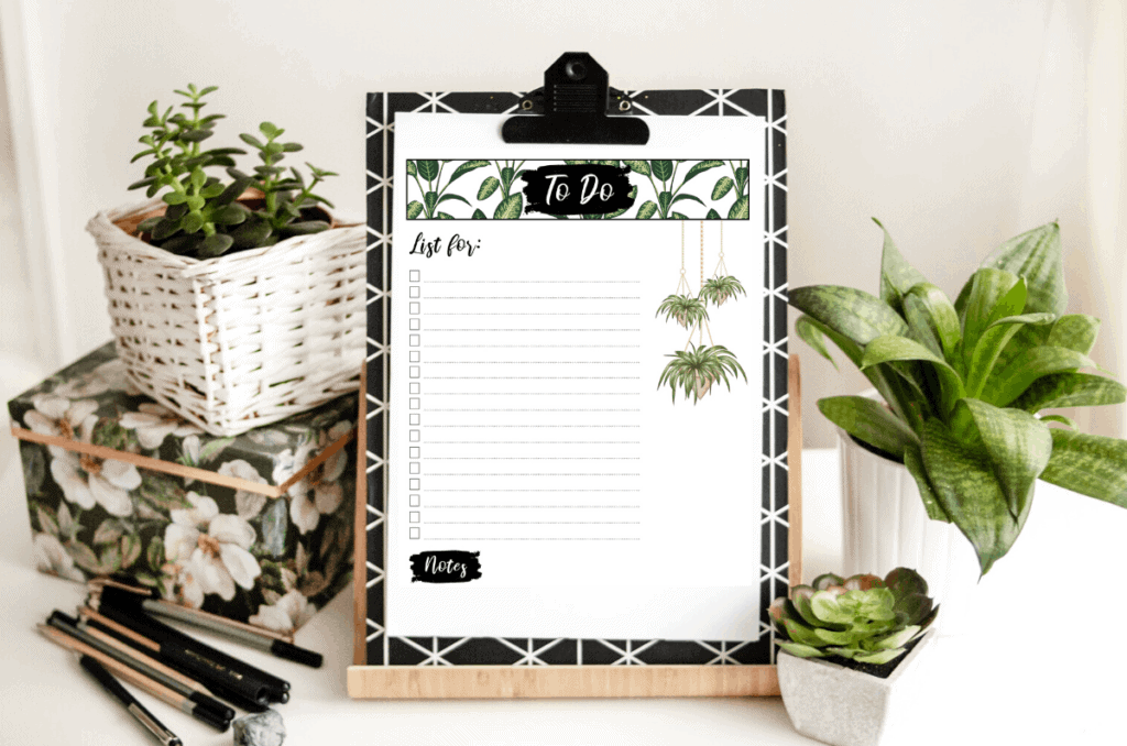 desk with a clipboard and an image of the free printable to do list