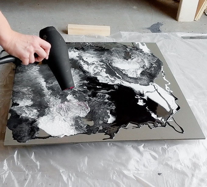 using a hair dryer to blow around the resin