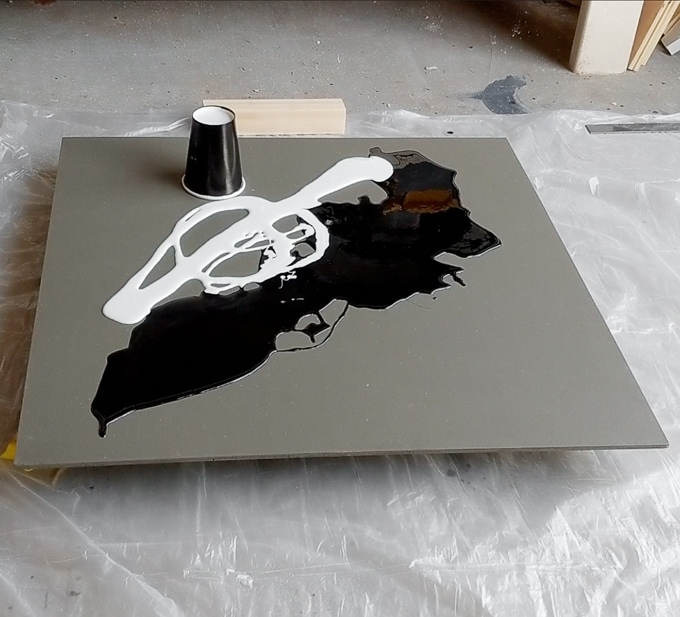 pouring colored resin onto the plywood