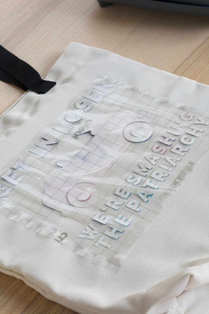 applying infusible ink to a tote bag