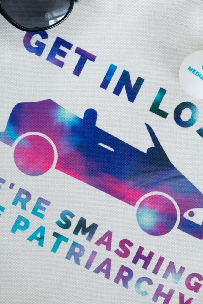 cricut infusible ink feminist tote bag that says get in loser we're smashing the patriarchy