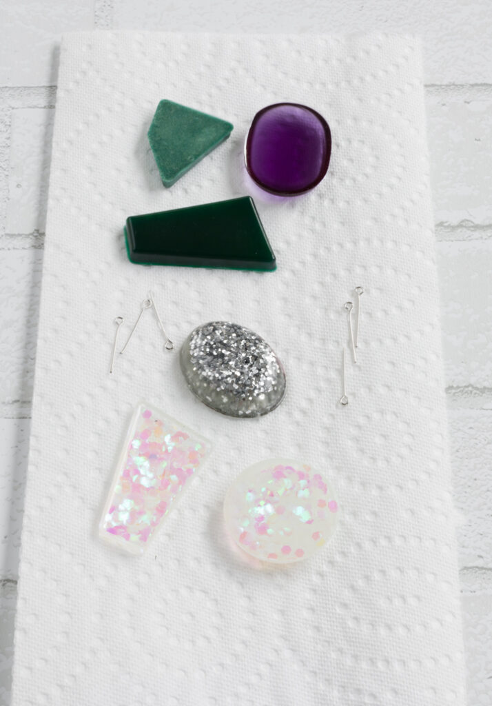 gluing jewelry hardware onto the resin jewelry pieces