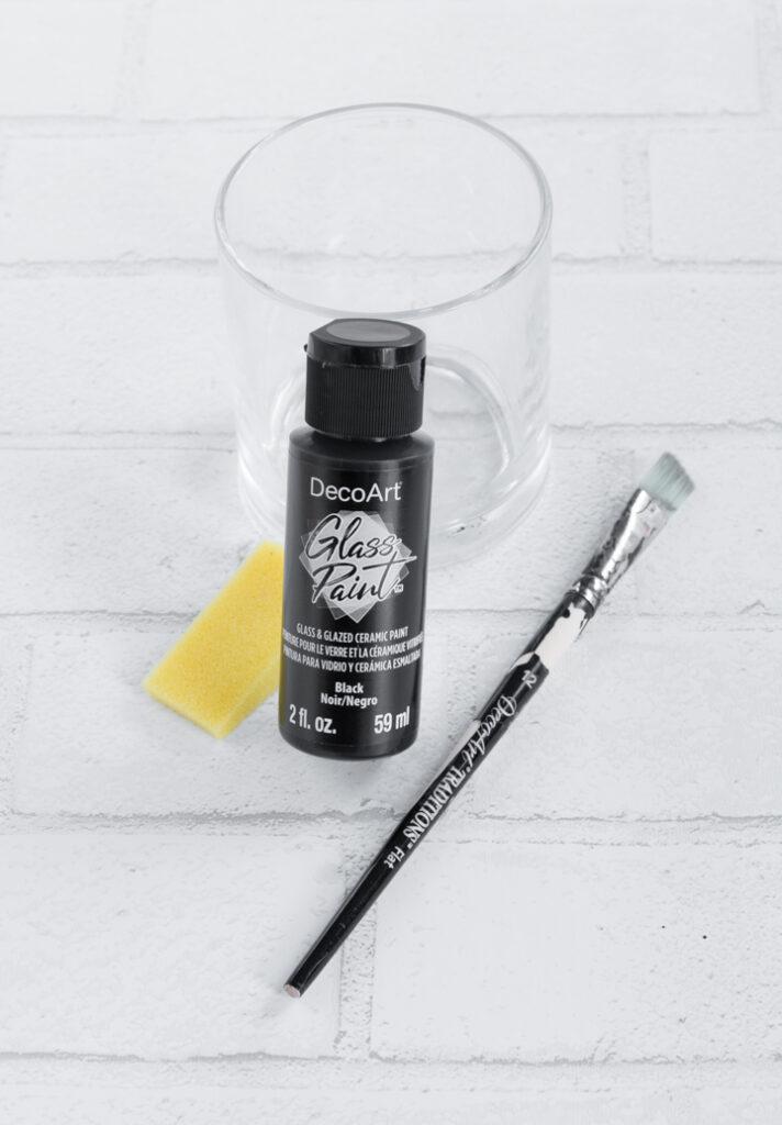 Decoart glass paint bottle on a table