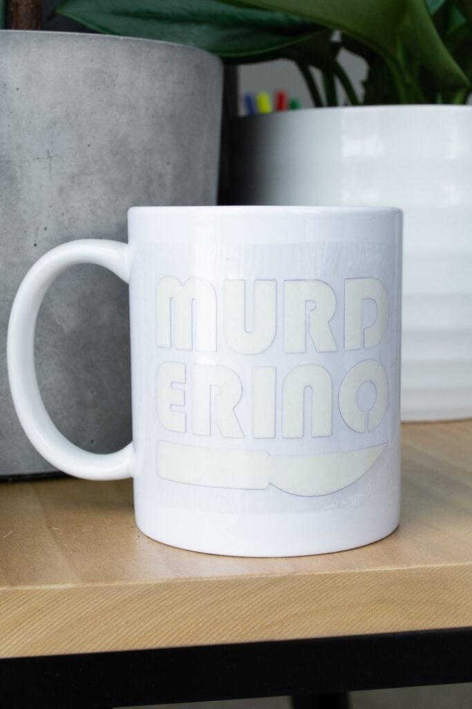 """Infusible Ink transfer sheet on a mug that says """"murderino"""""""
