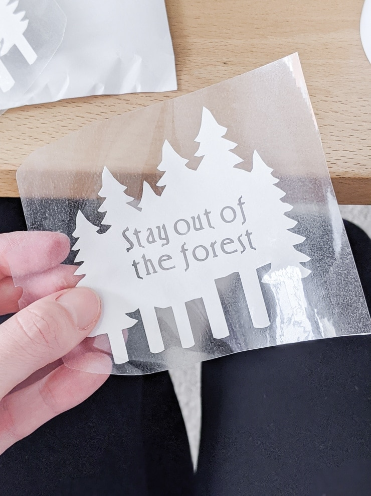 """Infusible Ink transfer sheet that says """"stay out of the forest"""""""