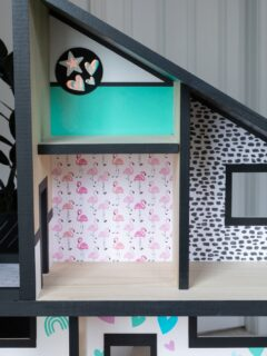finished DIY dollhouse wallpaper using scrapbook paper and adhesive vinyl