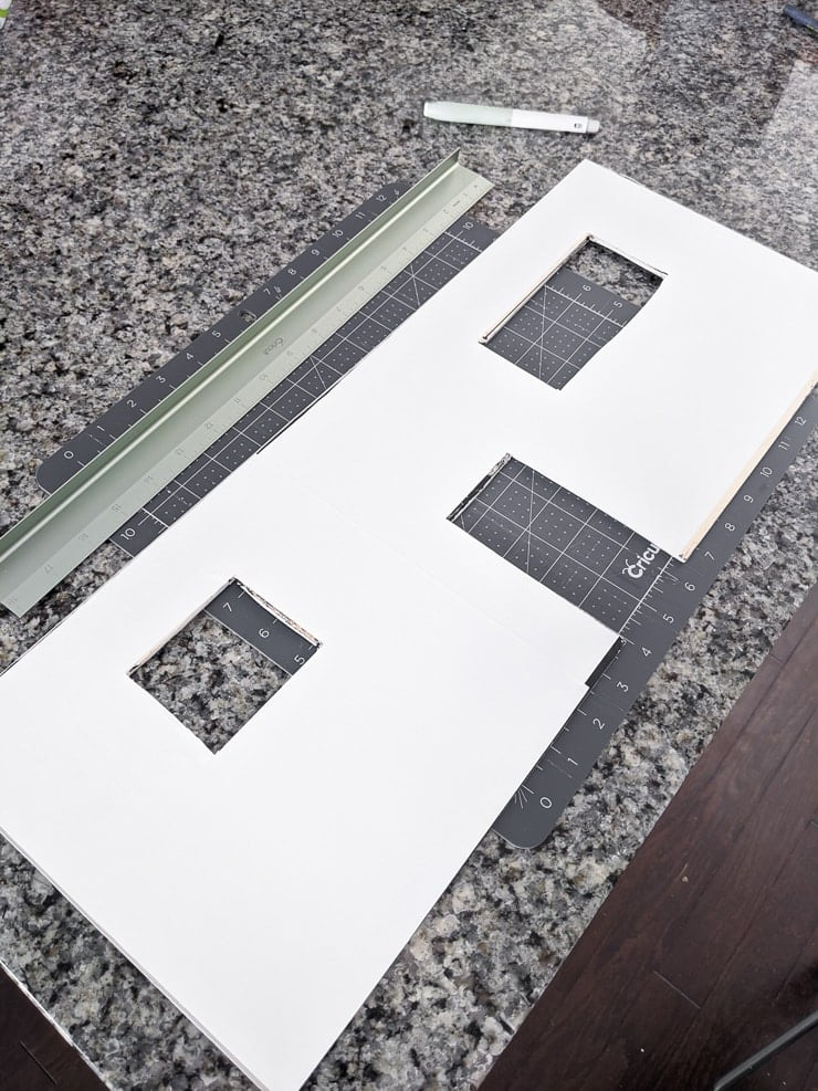 cutting adhesive vinyl by hand to make dollhouse wallpaper