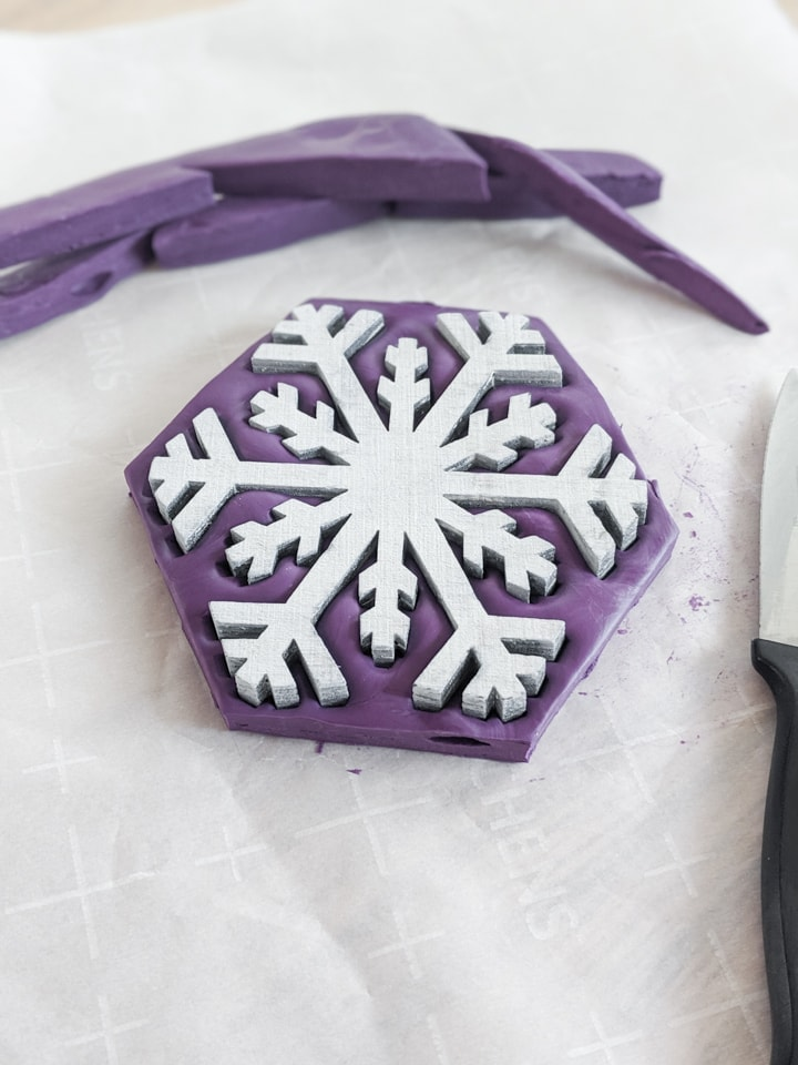 using putty to make a mold of a snowflake shape