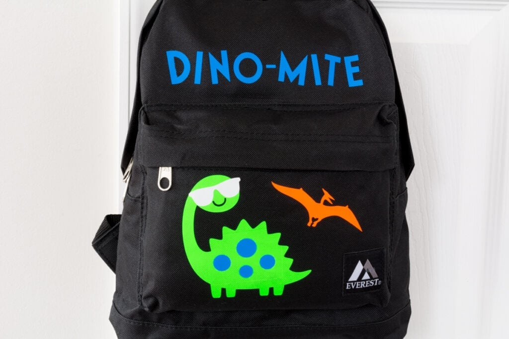 finished personalized backpack with dinosaurs on it