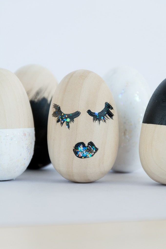 modern painted easter eggs laying on a table