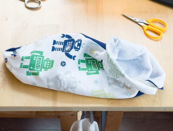 turning the burp cloth right-side out after sewing three sides