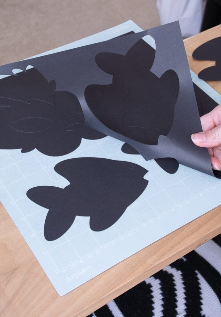 black paper fish cut out using a Cricut machine