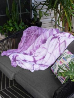 shibori blankets on an outdoor patio