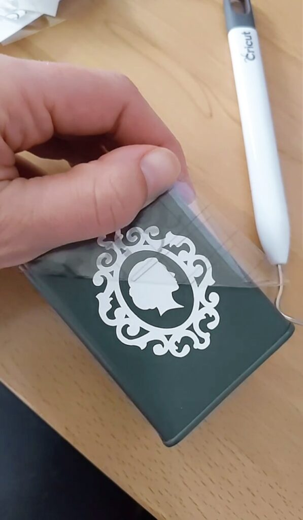 removing the transfer tape from the vinyl design