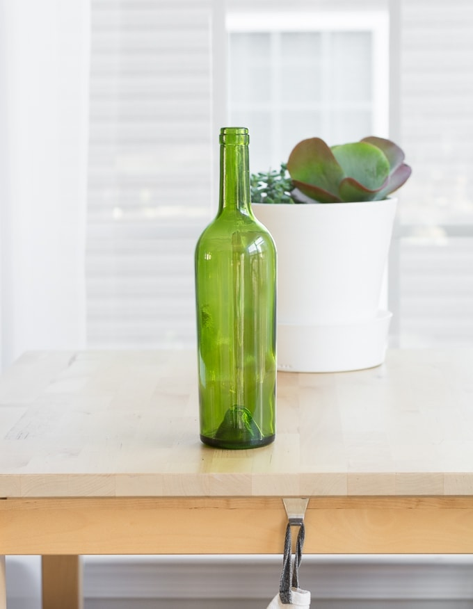 green wine bottle on a table