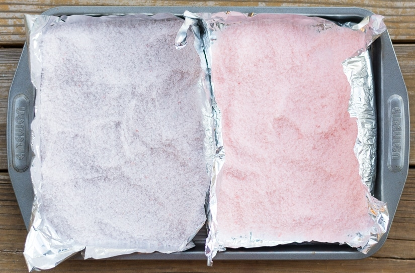 colored bath salts on a pan for baking
