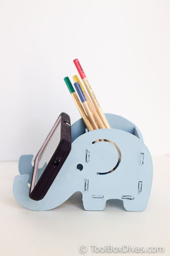 wooden phone and pencil holder made using a Cricut Maker knife blade