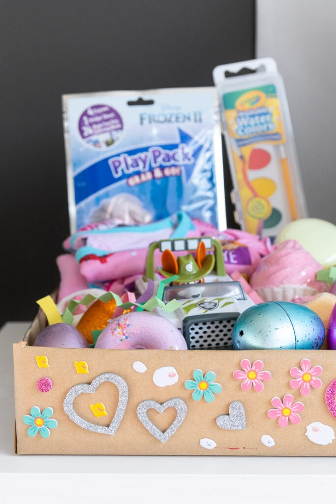 finished DIY Easter basket using a cardboard box and Easter grass made using paper