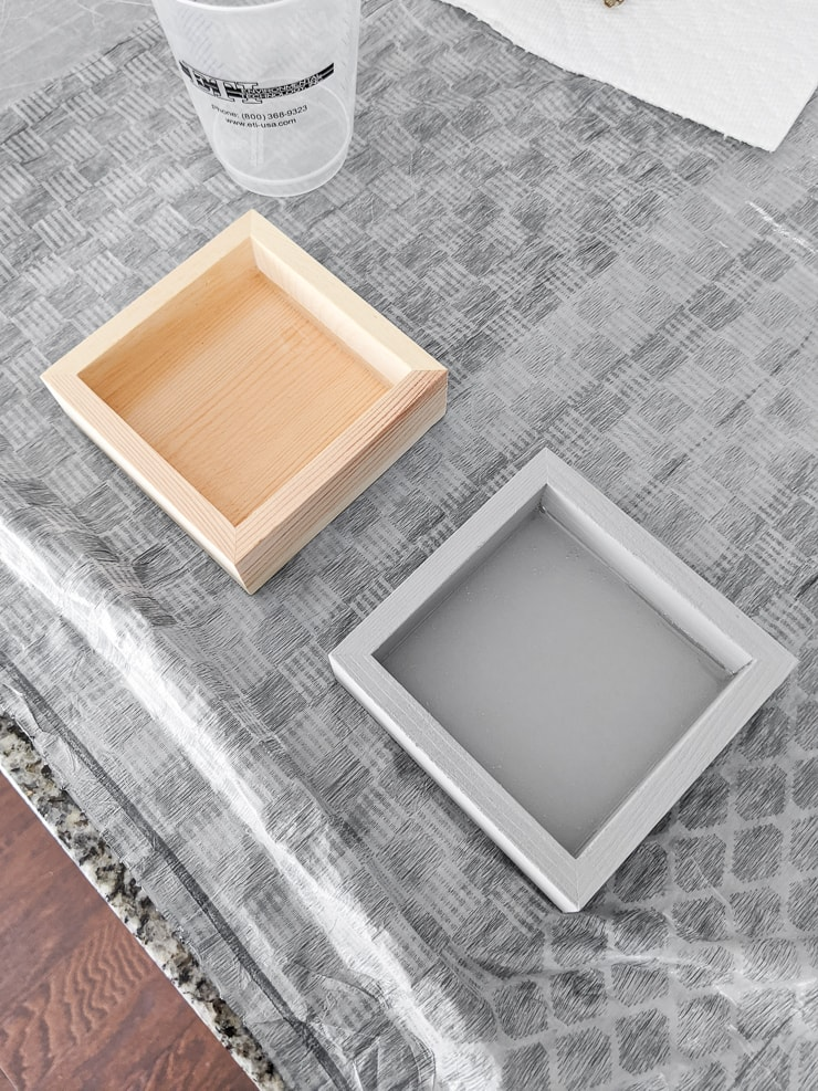 adding resin to small wooden trays