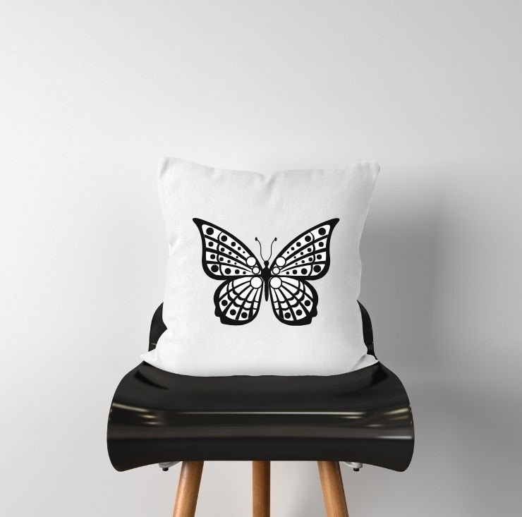 free fancy butterfly SVG file mocked up on a pillow