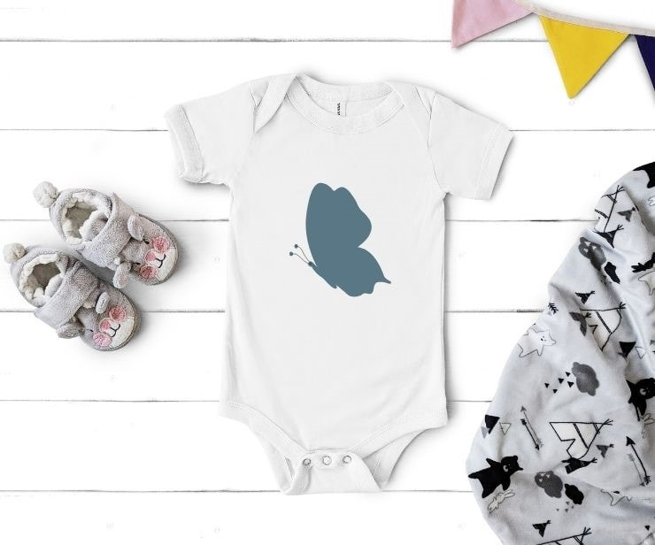 free simple butterfly cut file mocked up on a baby bodysuit