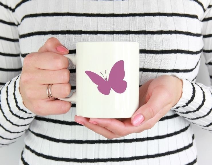 free simple butterfly cut file mocked up on a coffee cup