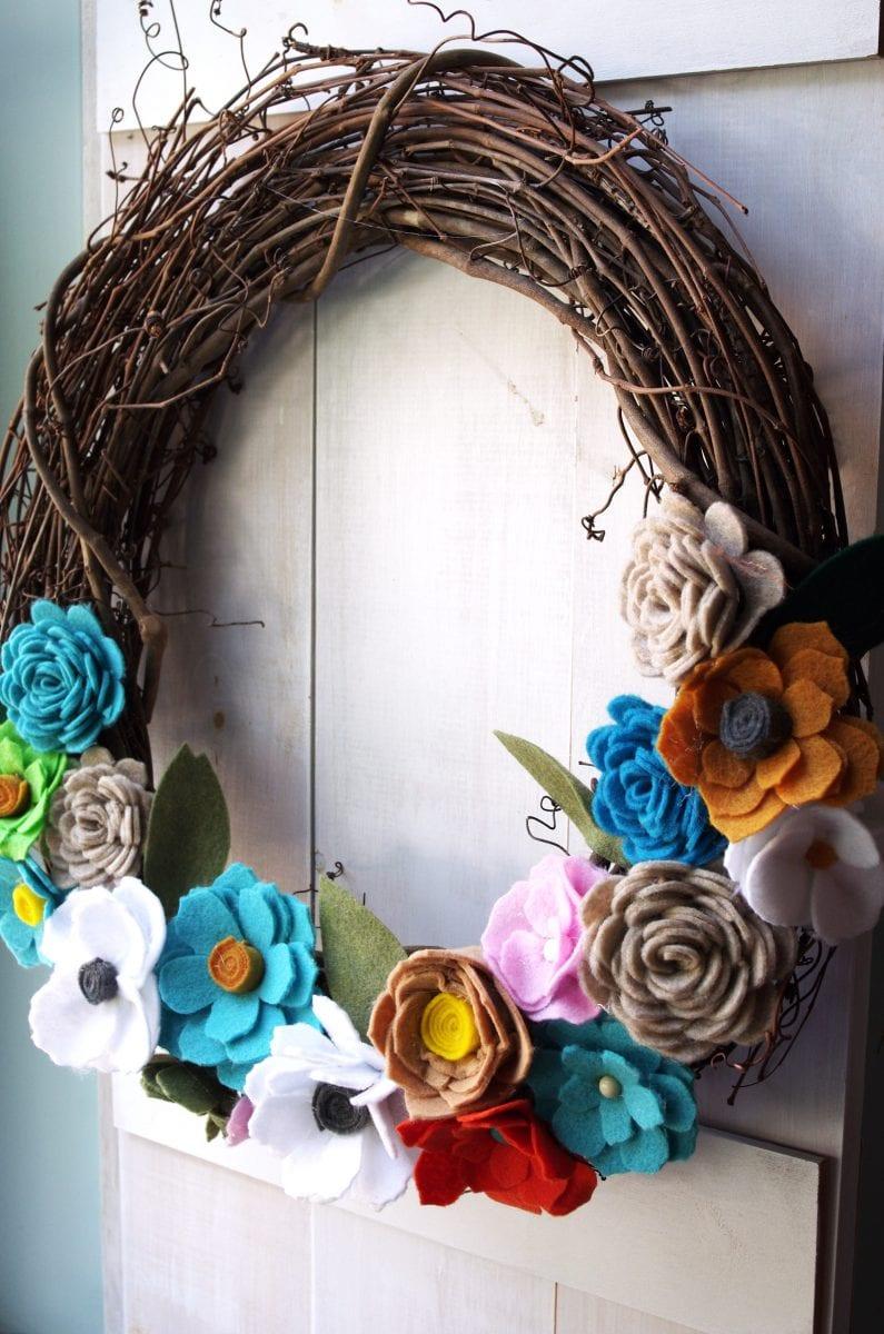 wreath with felt flowers that were made on a Cricut machine