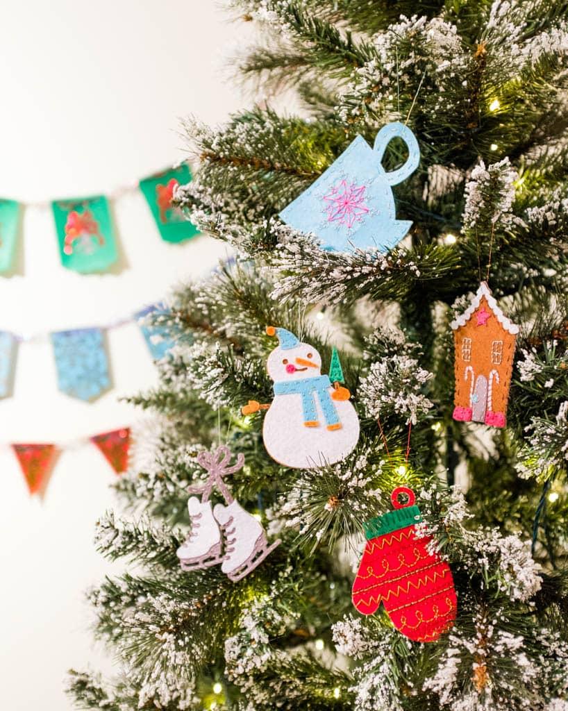 snowman, mitten teacup felt ornaments on a Christmas tree
