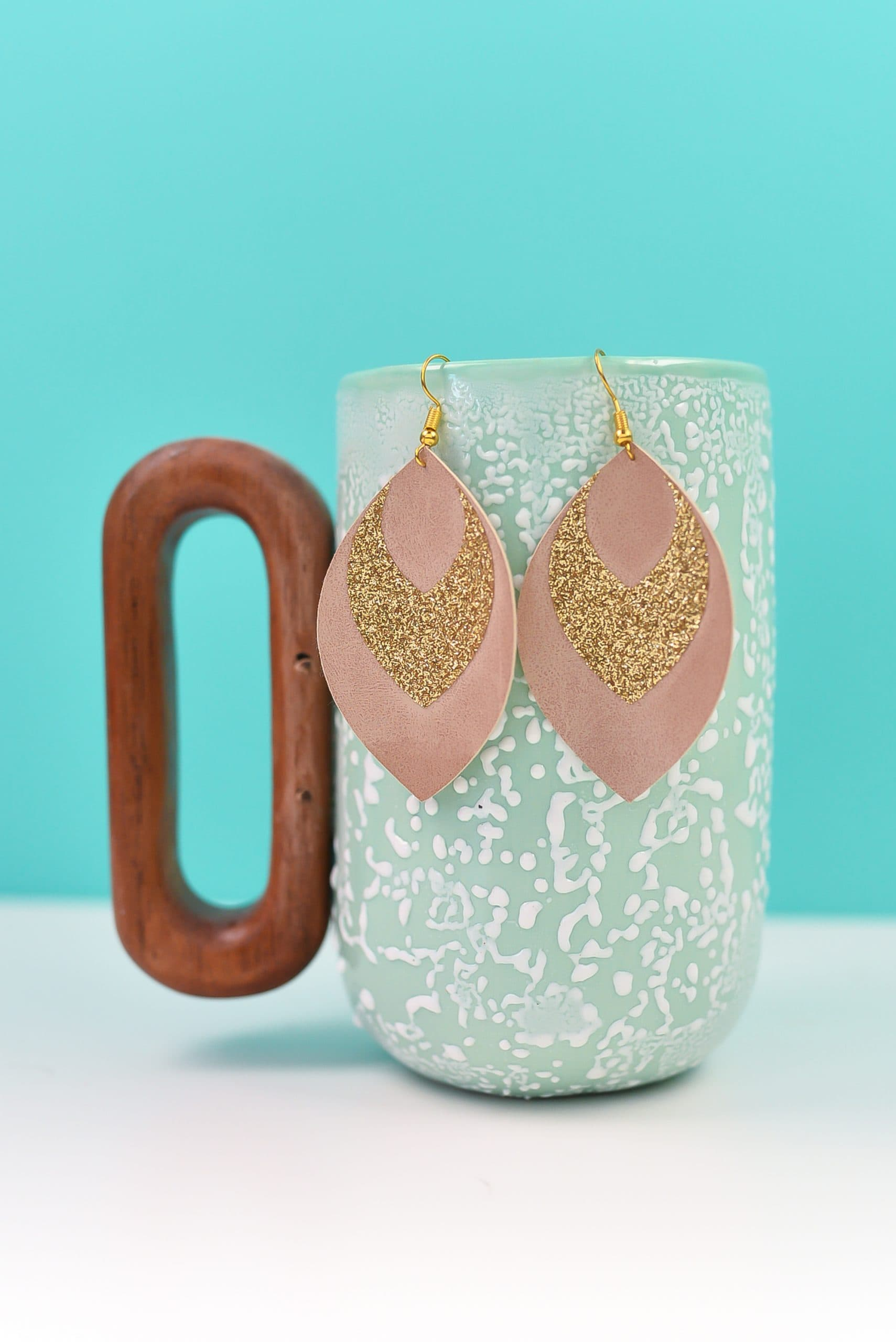 leather earring with glitter made with a Cricut