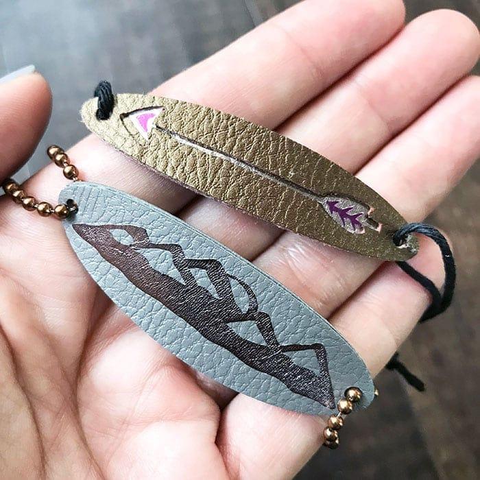 leather feather bracelet and leather bracelet with mountains
