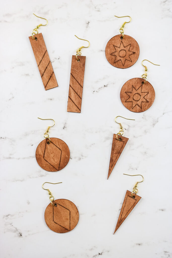 wooden earrings made and engraved with Cricut