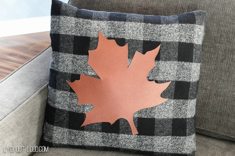 buffalo checked pillow with leather maple leaf