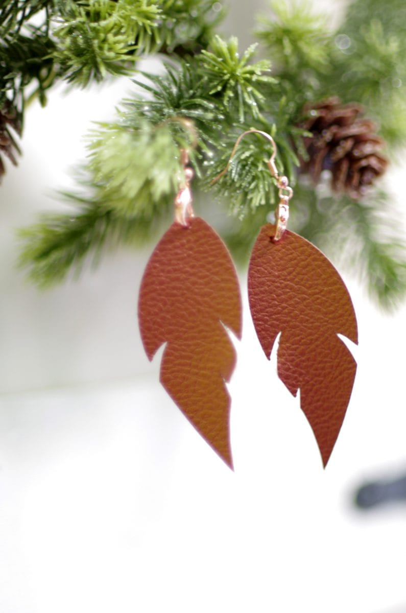 feather shaped leather earrings made with Cricut