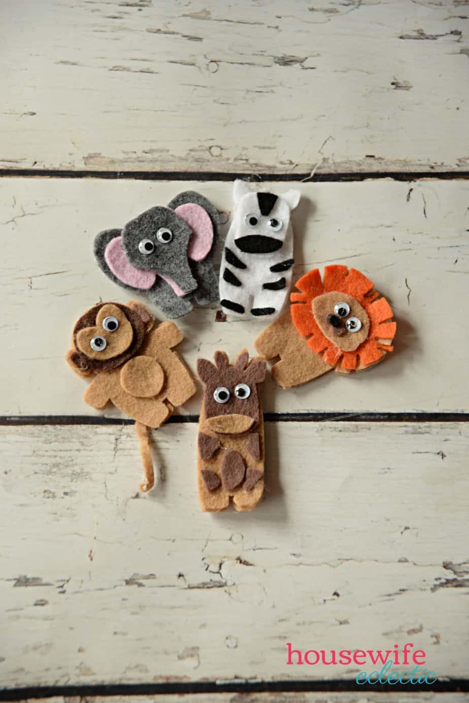 monkey, elephant, zebra, giraffe, and lion finger puppets made from felt on a Cricut