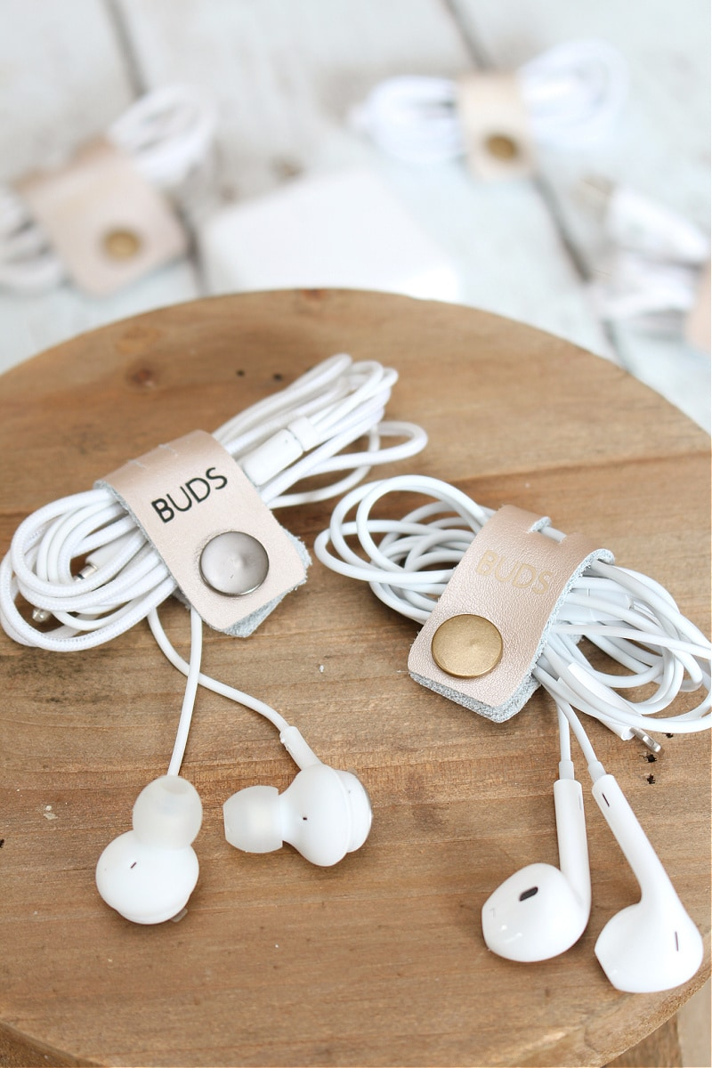 earbuds wrapped in leather cord organizers