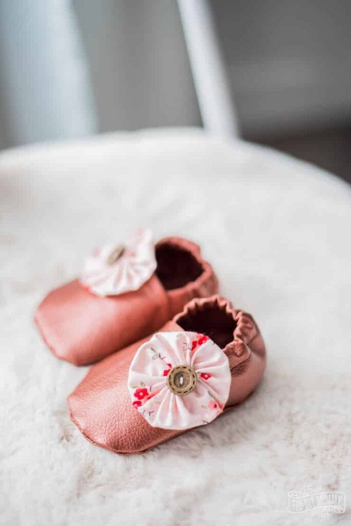 pink leather baby slippers made using a Cricut