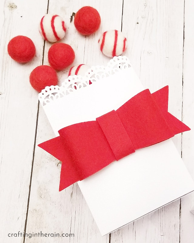 red bow made with felt on package