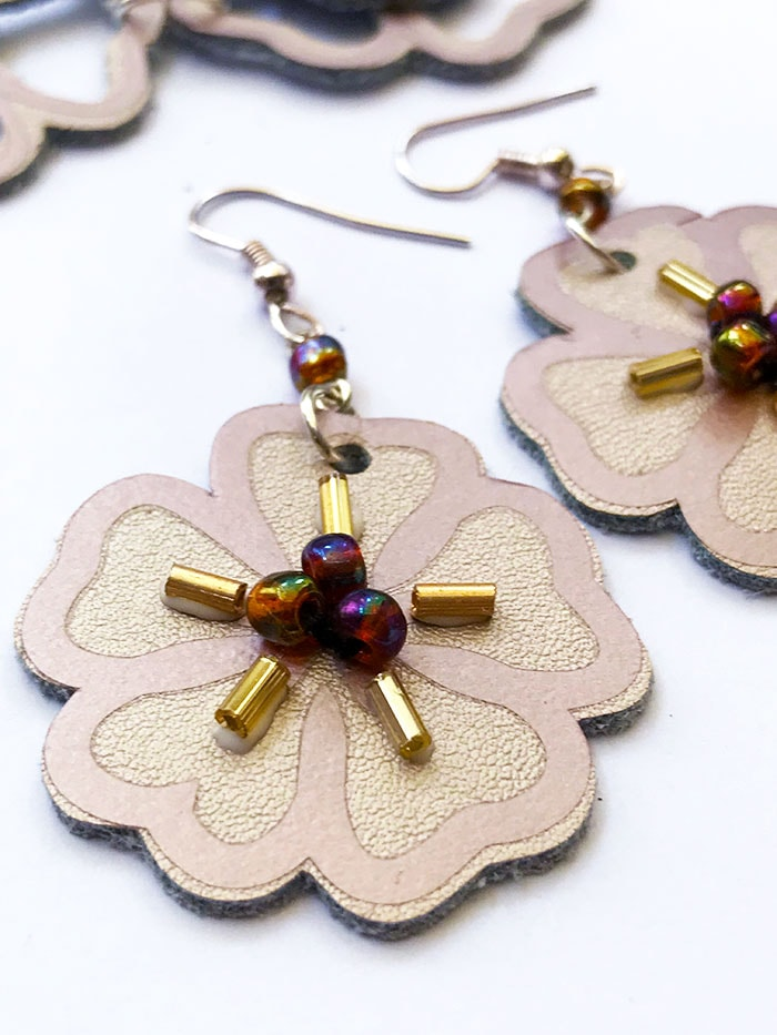 clover shaped earring with beads