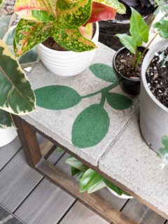 leaf painting on a concrete paver using a stencil
