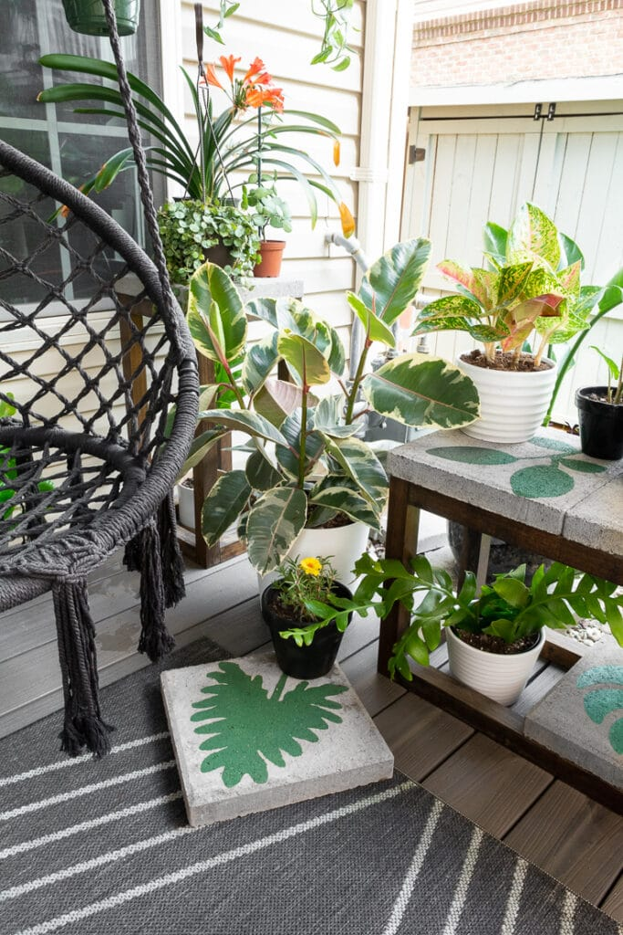 plants on a deck with painted concrete pavers