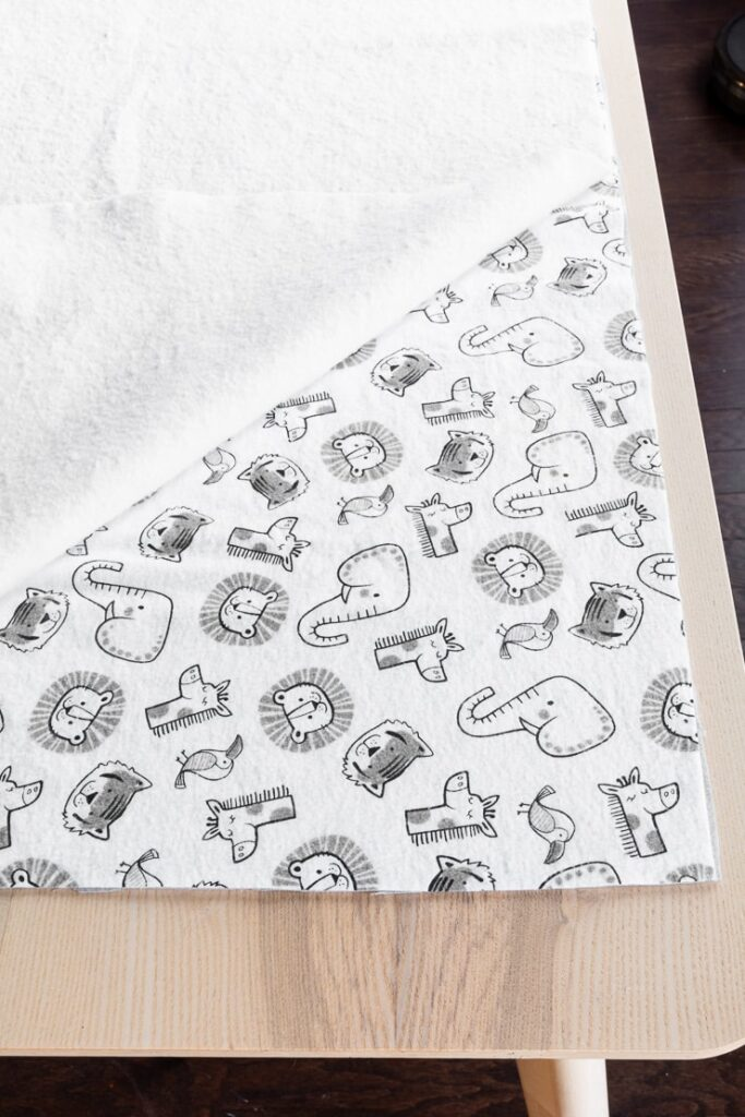 baby blanket fabric laid out on a table
