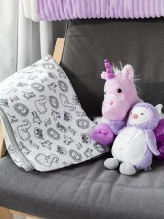 easy double-sided baby blanket sewing project on a rocking chair with stuffed animals
